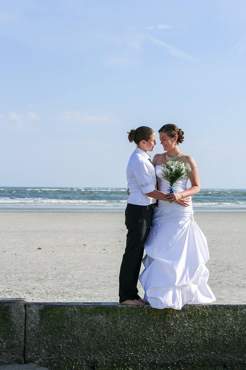 Gorgeous LGBT couple wedding photo on Tybee Island Beach - Elope to Savannah